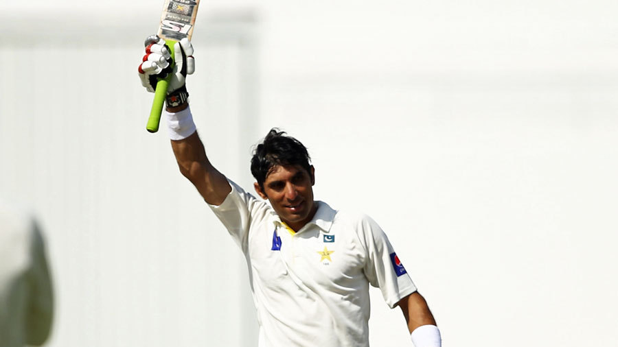 Misbah-ul-Haq raises his bat after a record Test century
