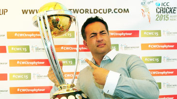 Former England captain Adam Hollioake poses with the World Cup trophy