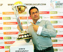 Former England captain Adam Hollioake poses with the World Cup trophy, Egbaston, August 23, 2014