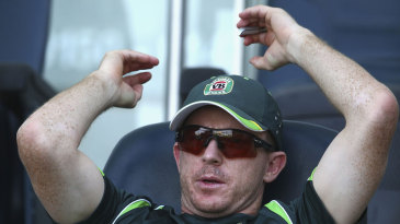 Chris Rogers watches from the players' area
