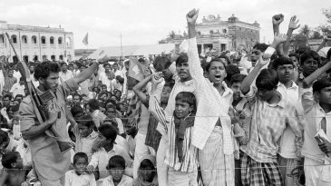 Crowds cheer the acting Bangladesh president and the acting government during a mass meeting in Jessore, East Pakistan