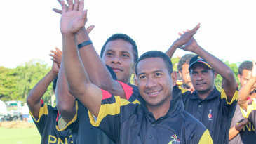The Papua New Guinea players celebrate their four-wicket win against Hong Kong