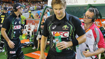 Shane Watson is miked up by the television crew before going out to bat
