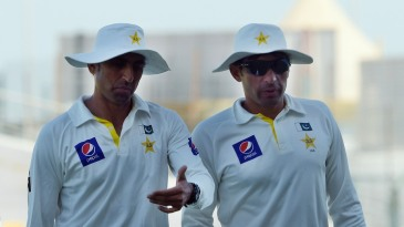 Younis Khan and Misbah-ul-Haq walk off after the victory