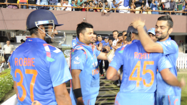 India team greets Rohit Sharma at the end of the innings