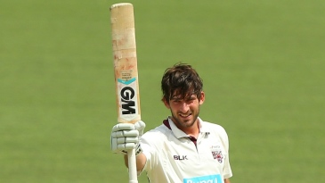 Joe Burns celebrates after reaching his century