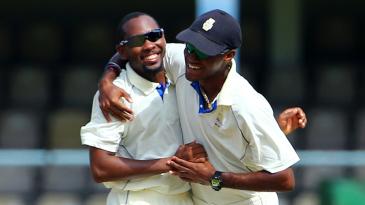Jomel Warrican and Kraigg Brathwaite celebrate a wicket
