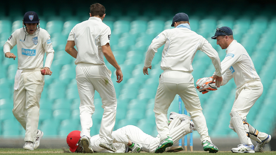 Phillip Hughes falls to the ground after being struck by a Sean Abbott bouncer