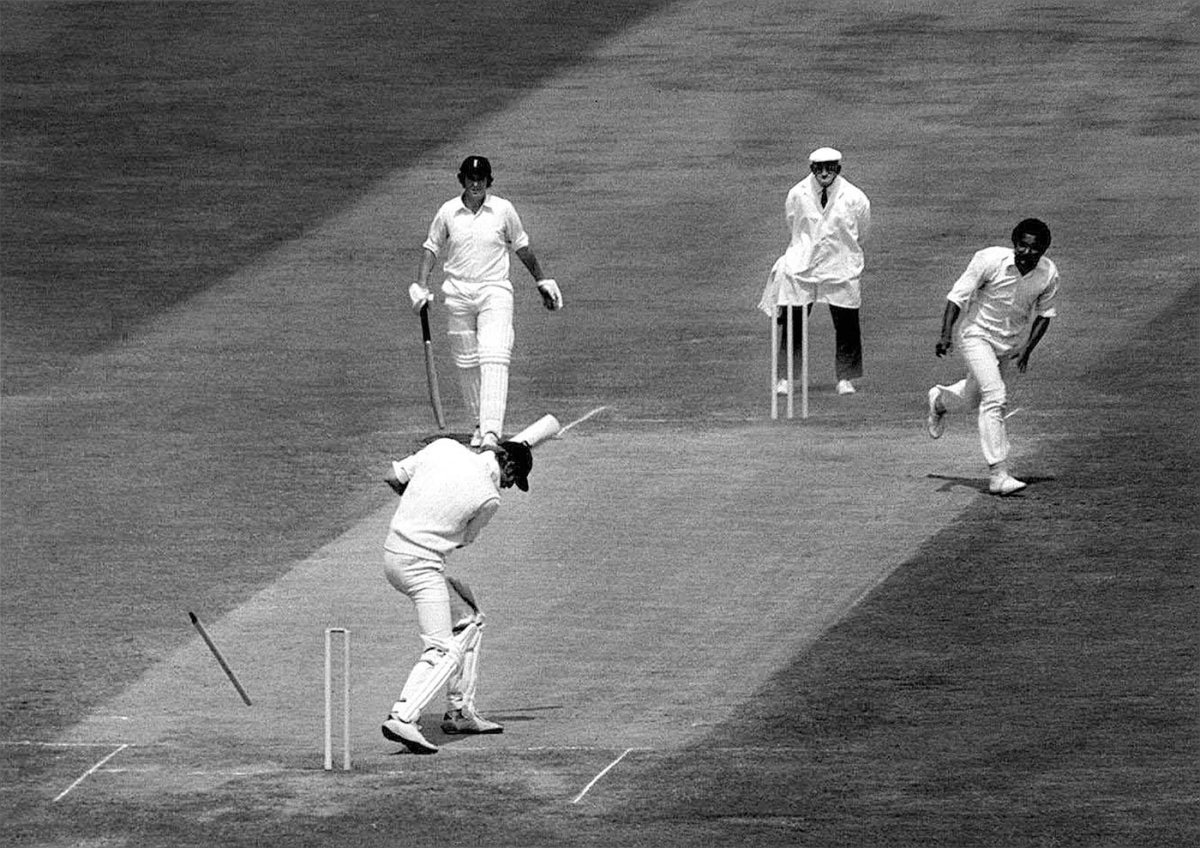 Tony Greig's stump flies out as he's bowled for a duck by Andy Roberts