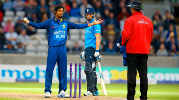 Sachithra Senanayake gestures to the umpire after mankading Jos Buttler