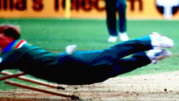 Jonty Rhodes dives at the stumps to run out Inzamam-ul-Haq