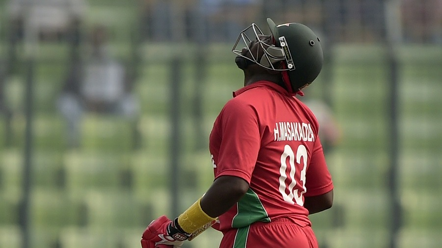 Hamilton Masakadza looks up after reaching his fifty