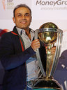 Virender Sehwag poses with the World Cup Trophy at a promotional event, Mumbai, December 2, 2014