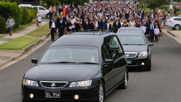 Phillip Hughes' funeral procession set out from the Macksville High School stadium