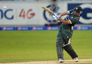 Awais Zia slams the ball down the ground, Pakistan v New Zealand, 1st T20, Dubai, December 4, 2014