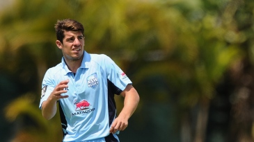 Moises Henriques walks back to his mark