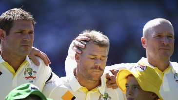 Brad Haddin puts a consoling hand on David Warner's head