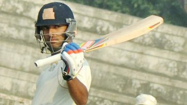 Yuvraj Singh celebrates his hundred against Haryana