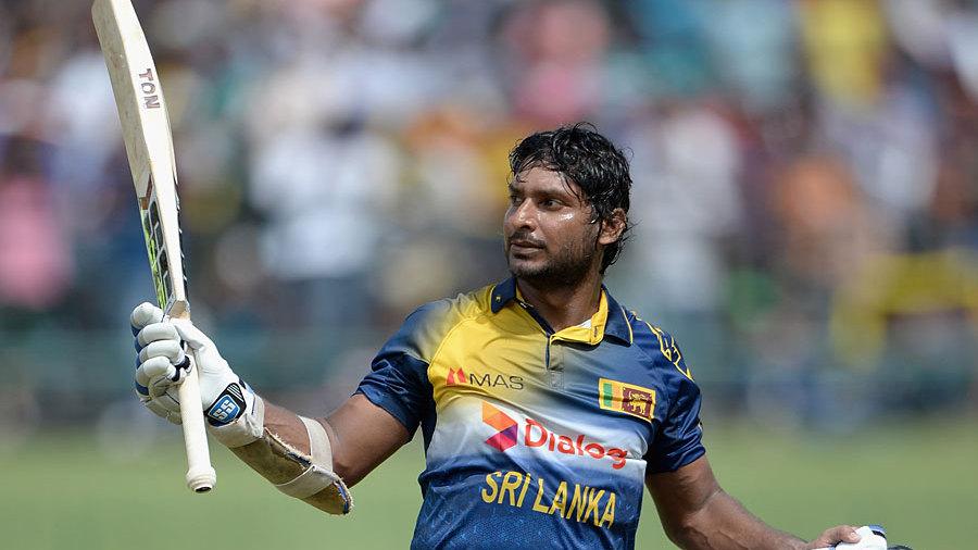 Kumar Sangakkara salutes the crowd as he walks off for 112