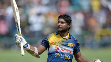 Kumar Sangakkara salutes the crowd as he walks off for 112
