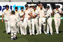 Australia gather around Mitch Marsh after he completes the catch to dismiss Virat Kohli, Australia v India, 1st Test, Adelaide, 5th day, December 13, 2014