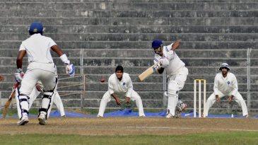 Arun Karthik pushes the ball down the ground