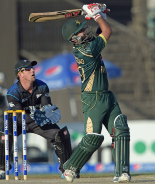 Ahmed Shehzad whacks the ball over the leg side, Pakistan v New Zealand, 3rd ODI, Sharjah, December 14, 2014