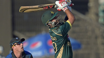 Ahmed Shehzad whacks the ball over the leg side