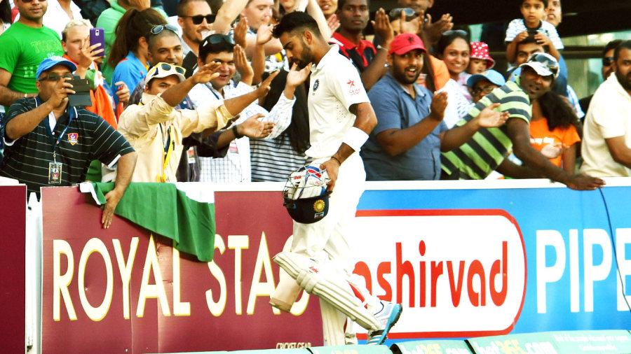Virat Kohli walks back after his dismissal