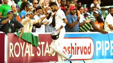 Virat Kohli walks back after his dismissal
