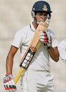 Sudip Chatterjee kisses his bat after reaching 50, Bengal v Karnataka, Ranji Trophy, Group A, Kolkata, 3rd day, December 16, 2014
