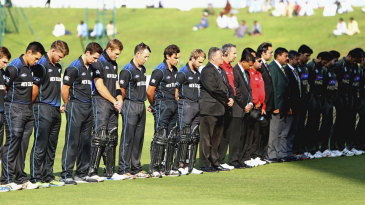 Match officials and the New Zealand and Pakistan teams observe two minutes of silence