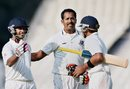 Shib Paul greets the two Karnataka batsmen who sealed the win, Bengal v Karnataka, Ranji Trophy, Group A, 4th day, Kolkata, December 17, 2014