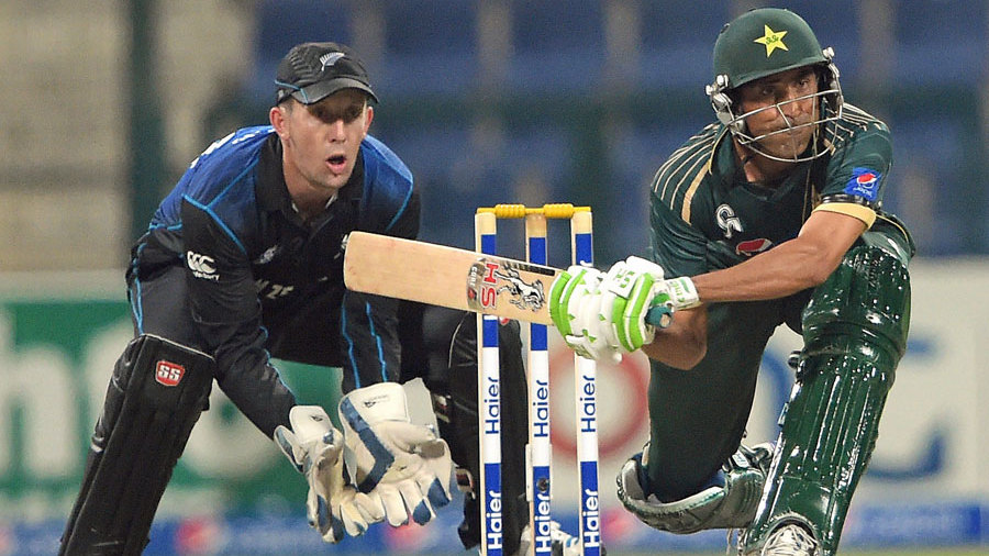 Younis Khan prepares to play a sweep shot