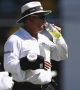 Marais Erasmus wears an ice pack after getting struck on the arm, Australia v India, 2nd Test, Brisbane, 3rd day, December 19, 2014