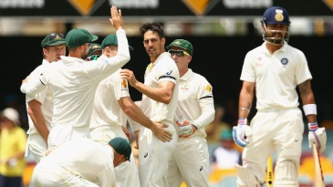 The Australians gather around Mitchell Johnson