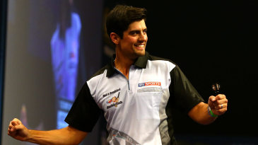 Alastair Cook plays a leg of darts against James Anderson