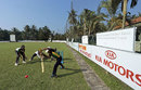 A young batsman practices his drive at the Surrey Village Ground, Maggona, Sri Lanka, December 5, 2014