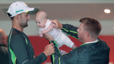David Warner introduces his baby to Nathan Lyon during a rain break