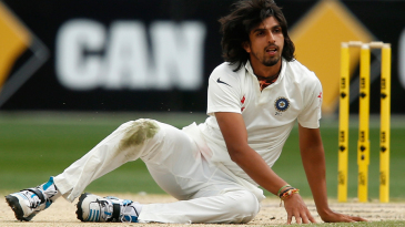 Ishant Sharma loses his footing after delivering the ball