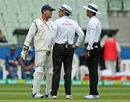MS Dhoni has a chat with the umpires as a drizzle comes down, Australia v India, 3rd Test, Melbourne, 5th day, December 30, 2014