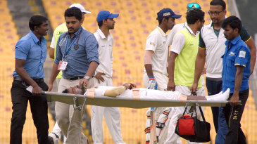 Rohan Bhosale is stretchered off the field