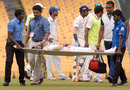 Rohan Bhosale is stretchered off the field, Tamil Nadu v Railways, Ranji Trophy 2014-15, Group A, Chennai, December 30, 2014