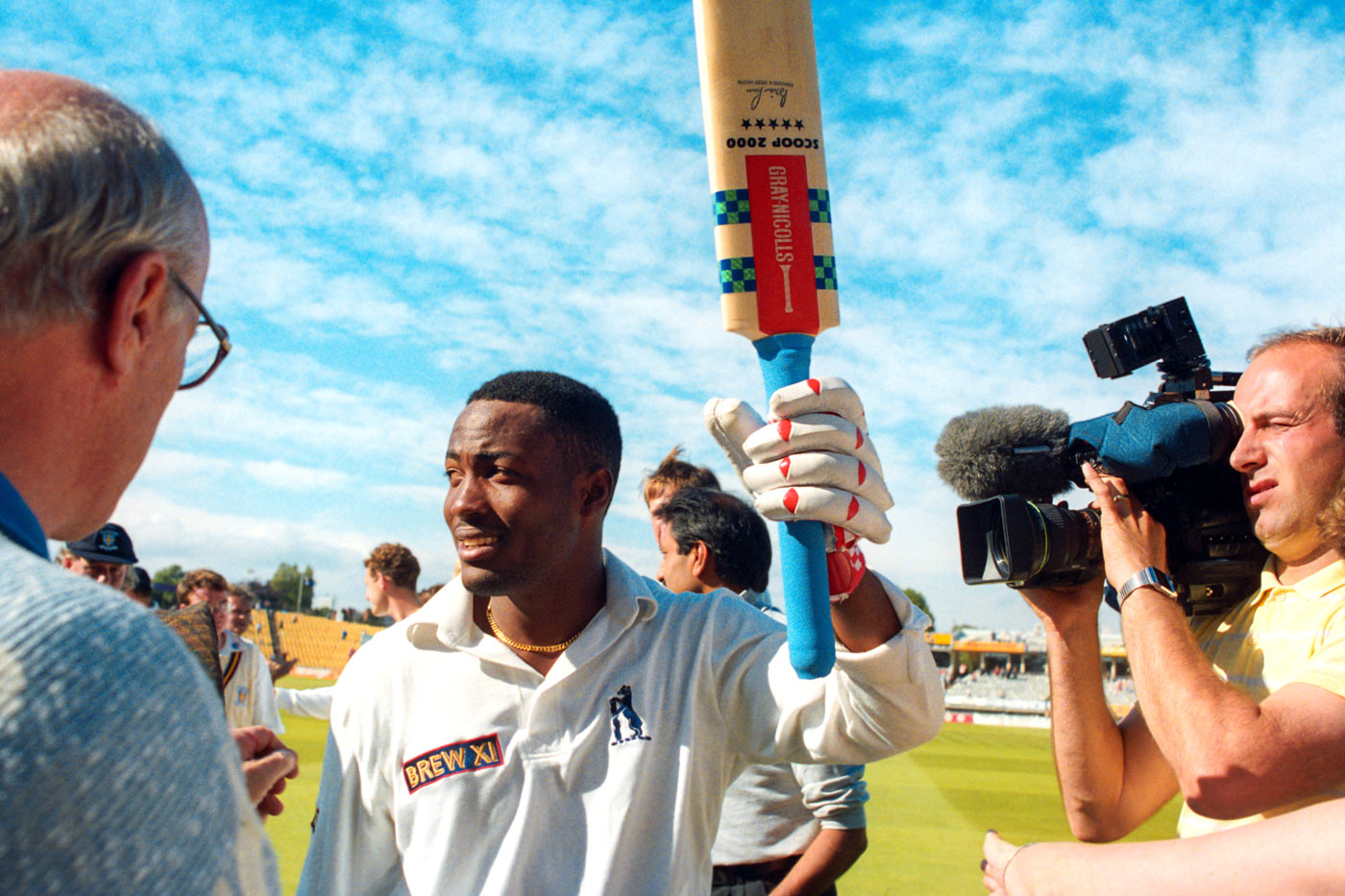 Brian Lara walks back after his record 501 not out