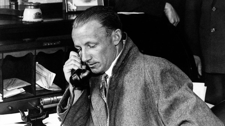 Don Bradman makes a telephone call