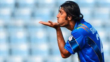 Shapoor Zadran blows a kiss to the departing batsman