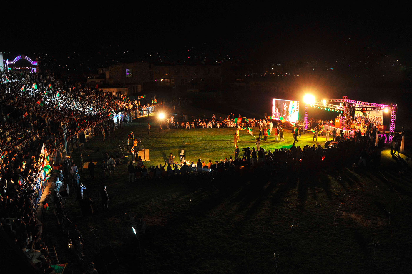 Home, victorious: crowds throng a stadium to welcome the team after it qualified for the World Cup, in October 2013