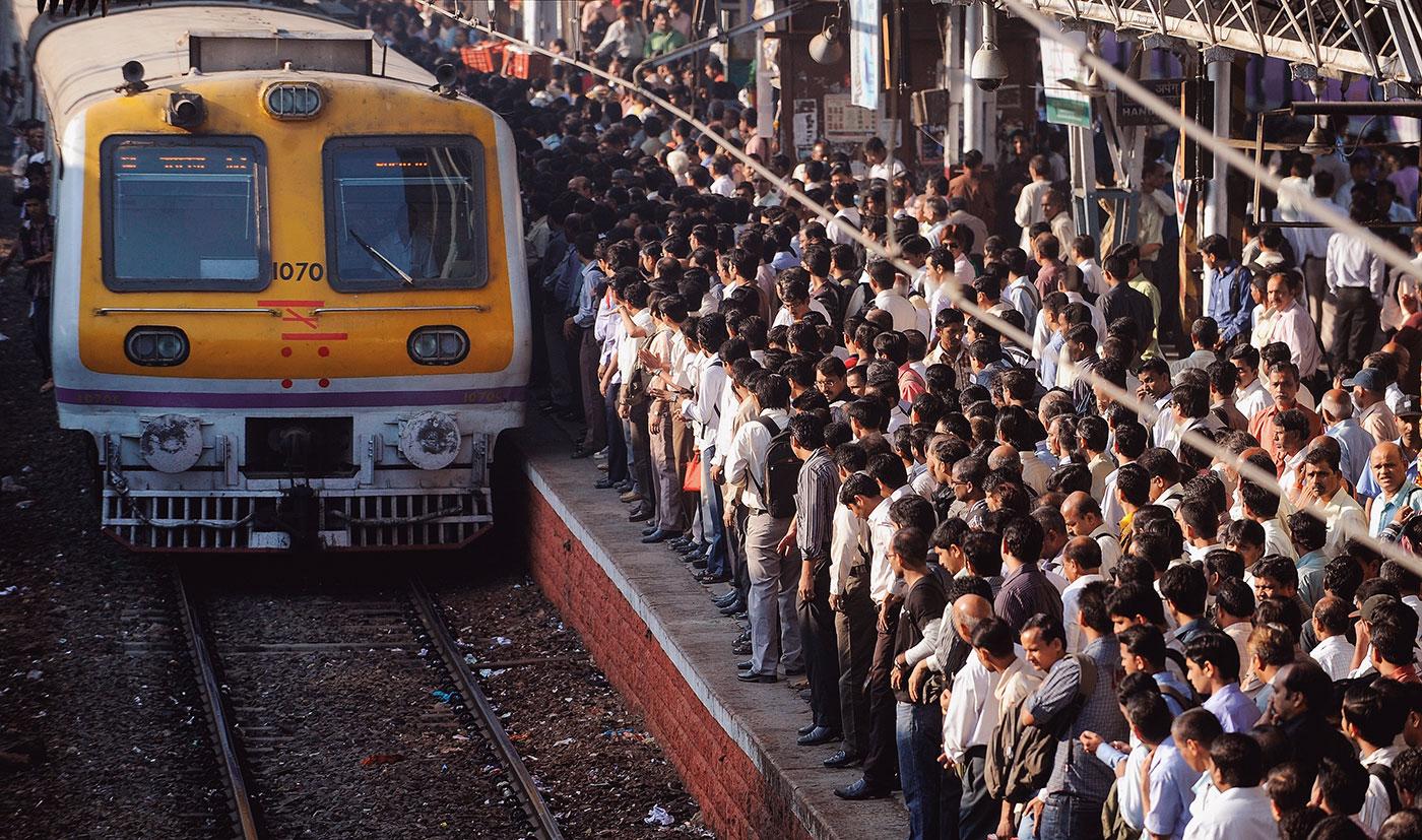 Crush hour: crowds wait at a Mumbai rail station; not too long ago, Rahane was among them