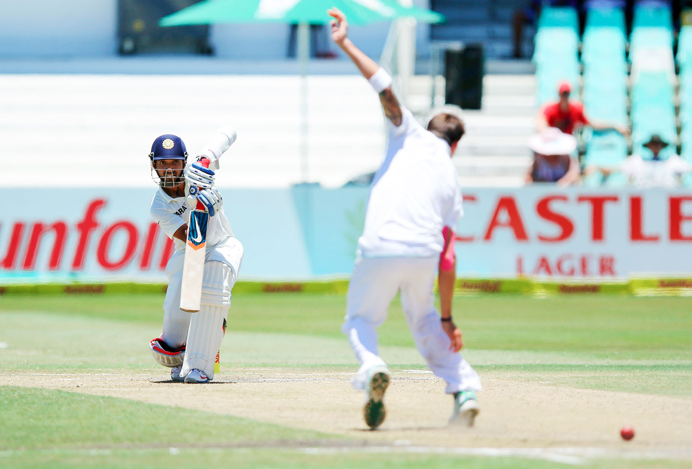 Last man driving: Rahane punches one down the ground off Dale Steyn on day five in Durban, 2013