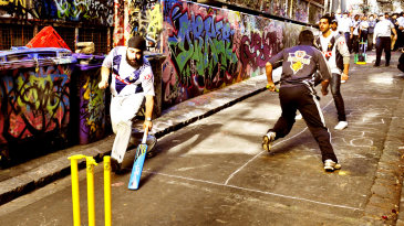Indian students play cricket in a laneway in Melbourne